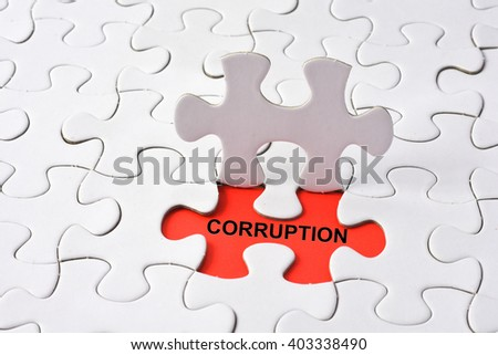 CORRUPTION concept on missing puzzle - stock photo