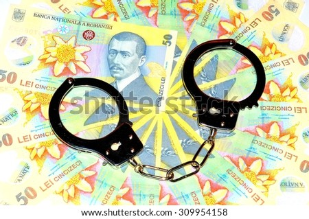 Corruption concept with Romanian currency (lei) and handcuffs - stock photo