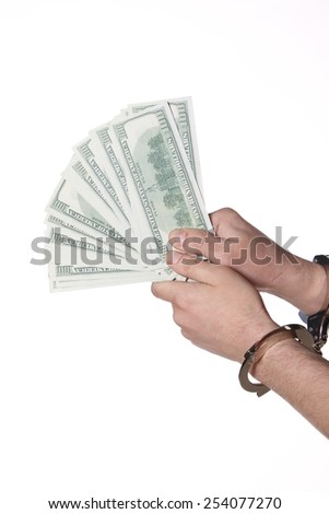 Corruption. hands in handcuffs hold money arrested isolated on white background