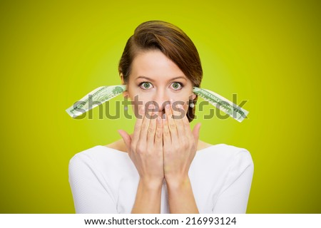 Corruption. It will keep me quiet. Bribery concept in politics, business, diplomacy. Corporate businesswoman plugs her ears with dollar banknotes, bills, covers her mouth, isolated green background  - stock photo