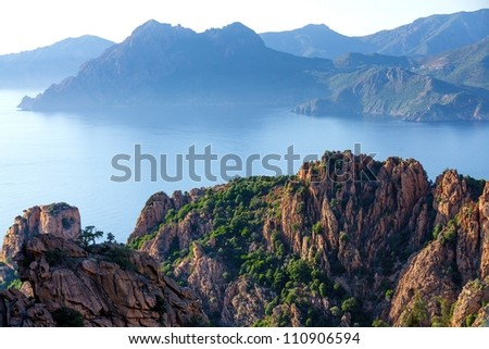 Corsica island rocky coastline called Calanche at sunset, France