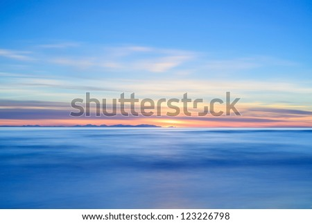Corsica or Corse and Capraia islands view from Italian beach coast on twilight sunset time. Mediterranean sea, Tuscany, Italy, Europe. Long Exposure Photography. - stock photo