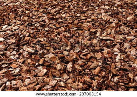 Cortex or wood chip background texture with small chips of natural wood to be used as a soil covering for mulch in the garden - stock photo