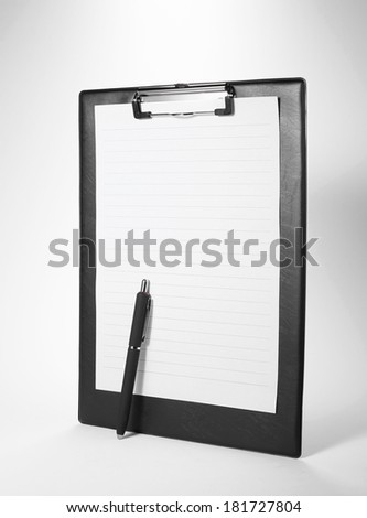 Cortical clip with pen board on white background - stock photo
