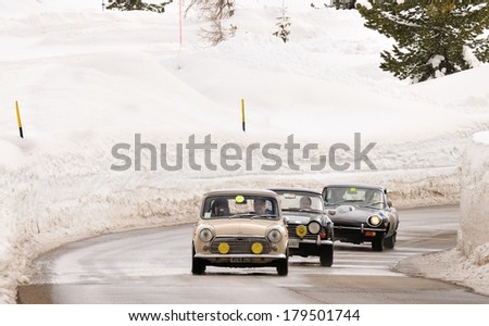 CORTINA D'AMPEZZO, ITALY - FEBRUARY 21: Three classic British cars take part to the WinteRace classic car race on February 21, 2014 in Cortina d'Ampezzo. - stock photo