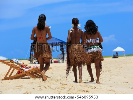 CORUMBAU , BRAZIL - DEC 28, 2016: Three Indian Girls, Indigenous native Brazilian , Guarani Tribe, on the beach in Bahia