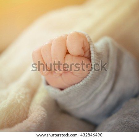 Cose-up shot of a foour week old newborn babys hand - stock photo