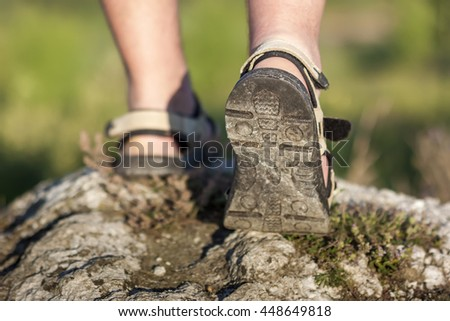Coseup of sport shoes on trail walking in mountains, outdoors activity