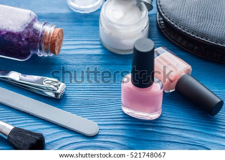 cosmetic and manicure set on wooden background