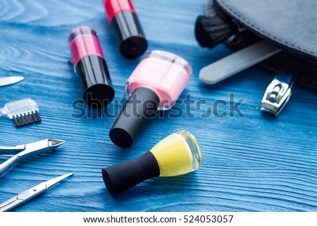cosmetic and manicure set on wooden background top view