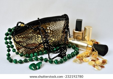 Cosmetic bag, makeup items, perfume in still life - stock photo