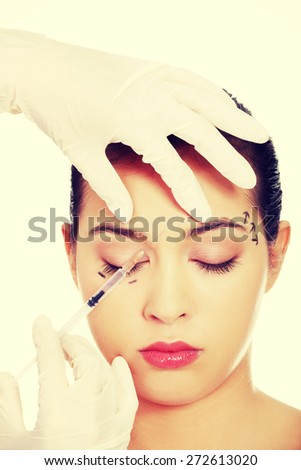 Cosmetic botox injection in the female face - stock photo