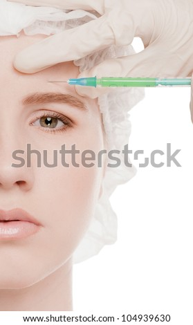 Cosmetic botox injection in the female face. Eye and eyebrow zone. Isolated on white
