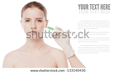 Cosmetic botox injection in the female face. Eye and eyebrow zone. Isolated on white - stock photo