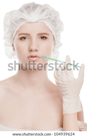 Cosmetic botox injection in the female face. Lips and cheek zone. Isolated on white - stock photo