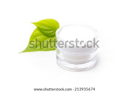 Cosmetic bottle container with green leaves, isolated on white background. - stock photo