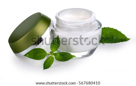Cosmetic bottle container with green leaves, isolated on white background. with clipping path