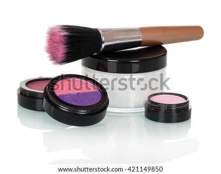 Cosmetic brush, eye shadow, blush and a jar of cream isolated on white background. - stock photo