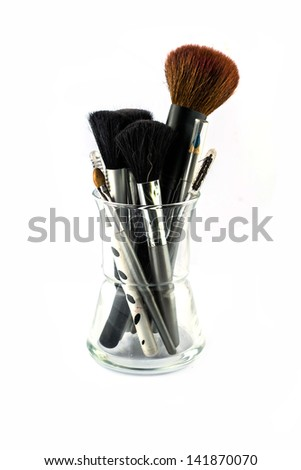 cosmetic brushes in glass
