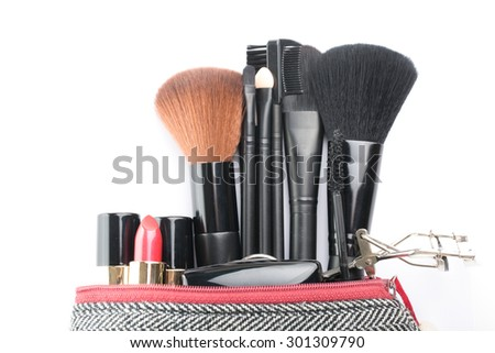 Cosmetic bush set for makeup your face on white background. - stock photo