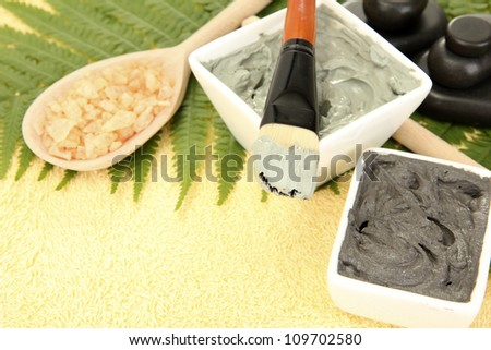 cosmetic clay for spa treatments on yellow background close-up - stock photo