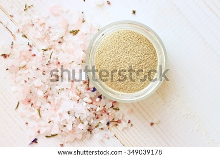 Cosmetic clay powder in jar and herbal aromatic salt. Healthy skin care. - stock photo