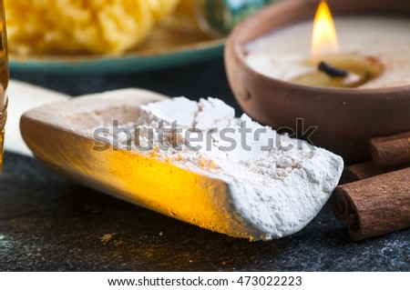 Cosmetic clay, spa treatment objects, sponge, aromatic candle, close up
