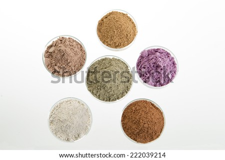 cosmetic clay: yellow, purple, pink, red, white, green for Spa and body care - stock photo