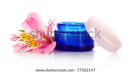Cosmetic cream and lily isolated on white background
