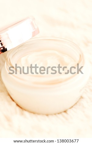 Cosmetic cream in an open jar with shallow depth of field