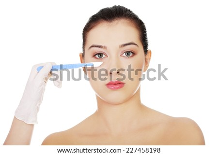 Cosmetic face surgery with scalpel - stock photo