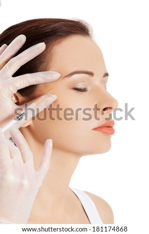Cosmetic injection in the female face - stock photo