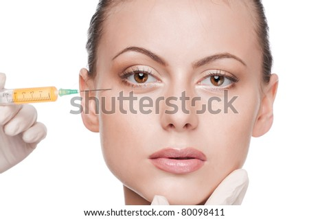 Cosmetic injection in the female face. Eye zone. Isolated
