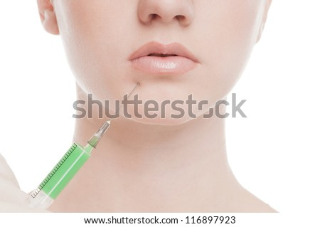 Cosmetic injection in the female face. Lips zone. Isolated on white