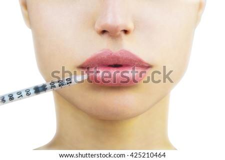 Cosmetic injection in the lower lip of unrecognizable woman, close-up. Beautiful big lips. Plastic and aesthetic surgery - stock photo