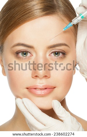 Cosmetic injection on the pretty woman face. Isolated on white background - stock photo