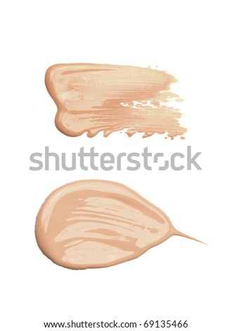 Cosmetic liquid foundation isolated on white background, tone cream smudged, concealer.