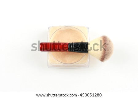 Cosmetic loose powder in jar with brush on white background.
