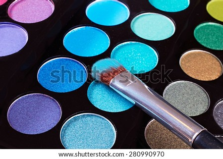 Cosmetic.Makeup blush with blue powder.Close up macro.Eye-shadow pallet for professional make up artist.  - stock photo