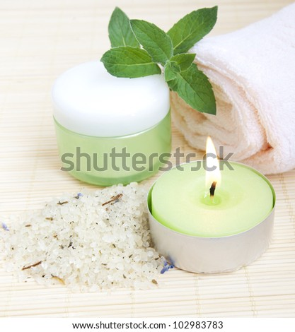 cosmetic moisturizing cream with mint, herbal sea salt  and towel
