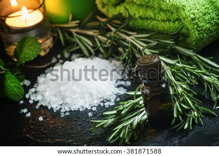 Cosmetic oil of rosemary, selective focus - stock photo