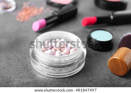 Cosmetic powder balls on grey background, close up