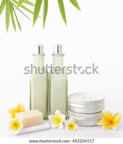 Cosmetic products on the white background with bamboo leaves