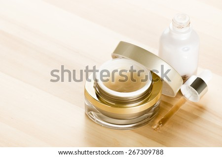 cosmetic serum on wood  - stock photo