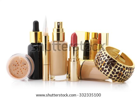 Cosmetic set: liquid foundation, concealer, mineral powder, lipstick, face serum and bracelet isolated on white background. - stock photo