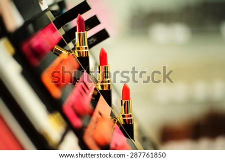 Cosmetic stand with a bright color palette of lipstick, horizontal picture - stock photo