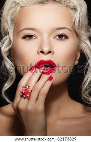 Cosmetics, accessories and romantic retro style. Sexy beautiful blonde female model with fashion make-up, sexy evening red lips makeup, bright nails with polish manicure and big cocktail ring