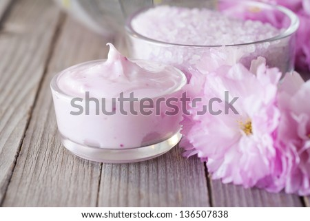 cosmetics and bath salts with beautiful japanese cherry blossoms - stock photo