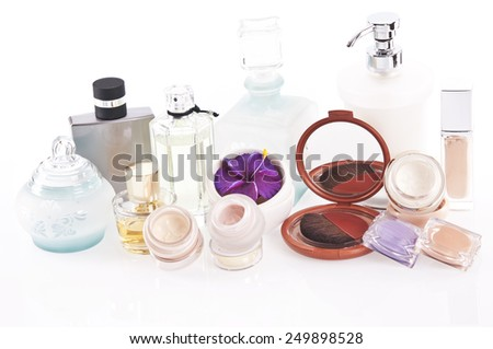 Cosmetics and perfume on white background - stock photo
