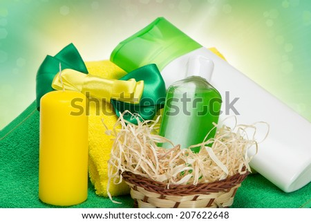 Cosmetics as a gift: composition with different cosmetic products for body care, wicker, candle, towels, bow